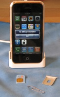 An activated iPhone with it's SIM card removed.